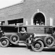 In 1930, a fleet of Industrial Towel vehicles delivers Kex towels to customers